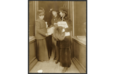 1917 Rep. Jeanette Rankin of Montana, left, reading The Suffragist