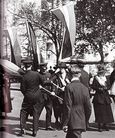 1917 Men Grab Banners
