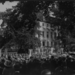 1922 National Woman's Party members and crowd gathered in front of the Alva E. Belmont House during its dedication ceremony